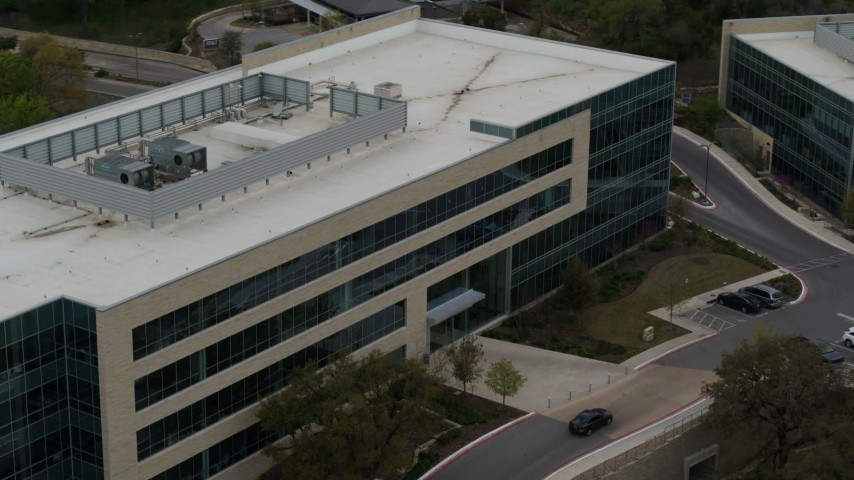 5.7K stock footage aerial video of slow orbit around a modern office building in Austin, Texas Aerial Stock Footage | DX0002_104_030