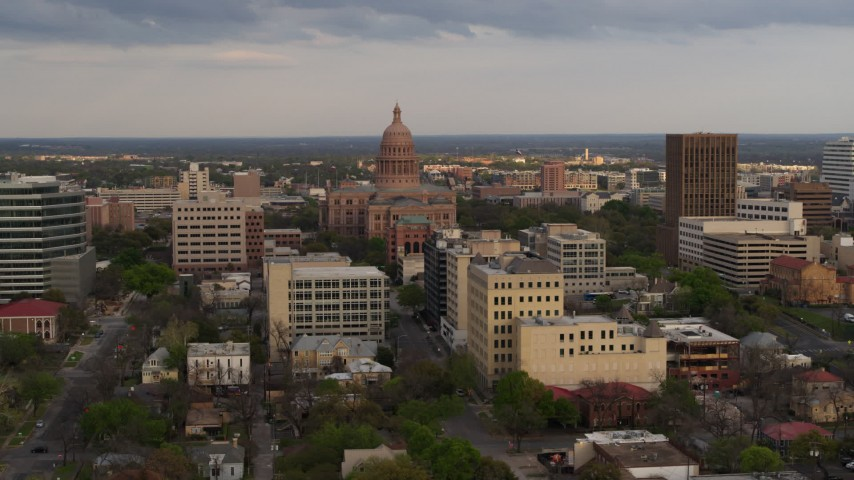 5.7K stock footage aerial video of the Texas State Capitol building at sunset in Downtown Austin, Texas Aerial Stock Footage | DX0002_104_032