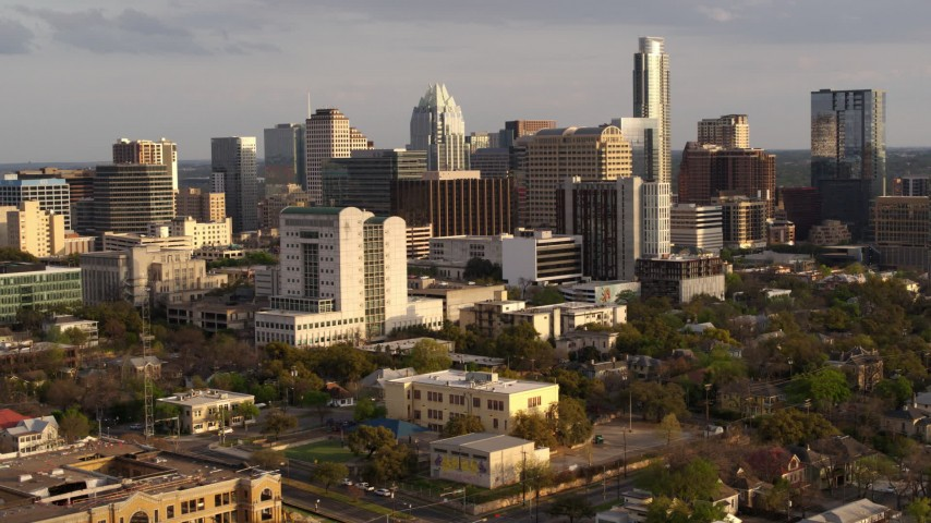 5.7K stock footage aerial video of a courthouse and office buildings near skyscrapers at sunset in Downtown Austin, Texas Aerial Stock Footage | DX0002_104_038
