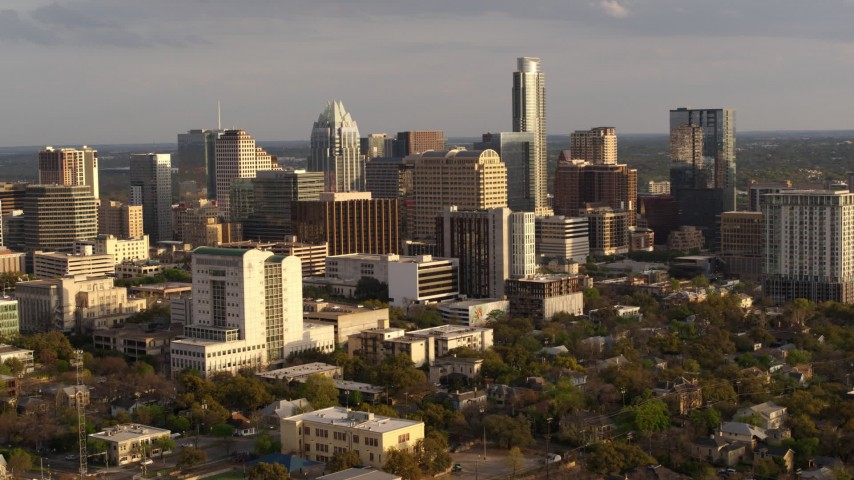 5.7K stock footage aerial video a slow approach to a courthouse and office buildings near skyscrapers at sunset in Downtown Austin, Texas Aerial Stock Footage | DX0002_104_041