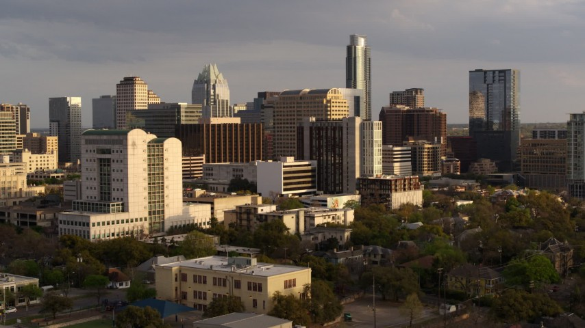 5.7K aerial video of office buildings and skyscrapers near courthouse at sunset in Downtown Austin, Texas Aerial Stock Footage | DX0002_104_047