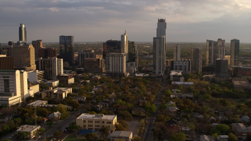 5.7K stock footage aerial video of a view of skyscrapers at sunset during ascent in Downtown Austin, Texas Aerial Stock Footage | DX0002_105_001