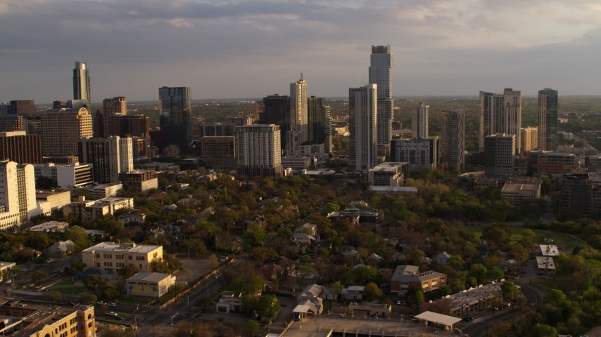 5.7K stock footage aerial video of flying by tall city skyscrapers at sunset in Downtown Austin, Texas Aerial Stock Footage | DX0002_105_002
