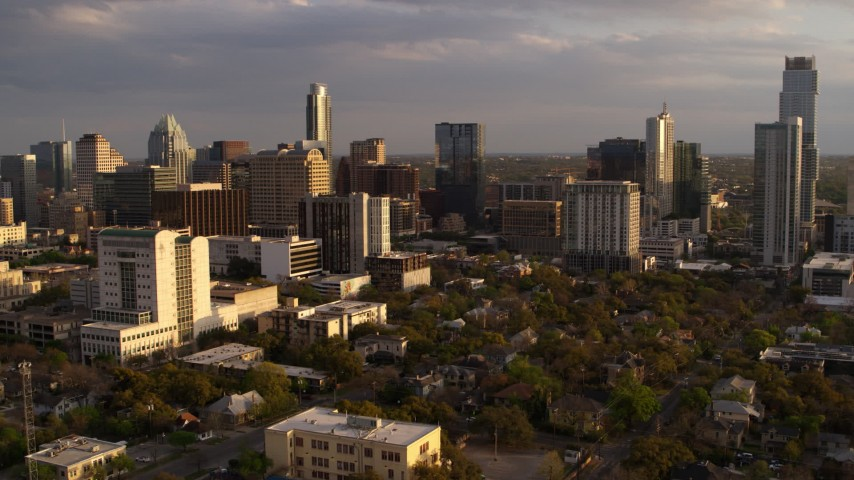 5.7K stock footage aerial video of office buildings and skyscrapers, flyby courthouse at sunset in Downtown Austin, Texas Aerial Stock Footage | DX0002_105_008