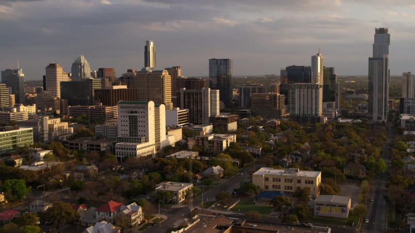 5.7K stock footage aerial video of office buildings and skyscrapers behind courthouse at sunset in Downtown Austin, Texas Aerial Stock Footage | DX0002_105_009