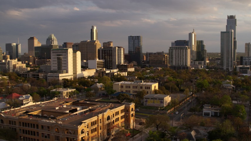 5.7K stock footage aerial video of office buildings and skyscrapers, fly low near courthouse at sunset in Downtown Austin, Texas Aerial Stock Footage | DX0002_105_010
