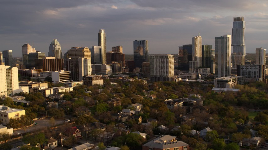5.7K stock footage aerial video ascend while focused on office buildings and skyscrapers at sunset in Downtown Austin, Texas Aerial Stock Footage | DX0002_105_011