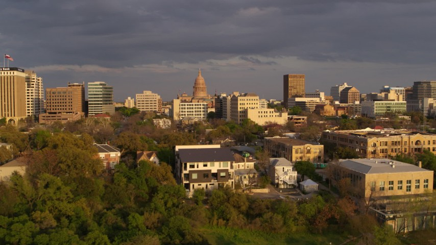 5.7K stock footage aerial video Texas State Capitol dome and office buildings at sunset in Downtown Austin, Texas Aerial Stock Footage | DX0002_105_013