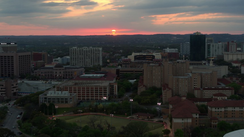 5.7K stock footage aerial video of the setting sun while descending near the university, Austin, Texas Aerial Stock Footage | DX0002_105_025