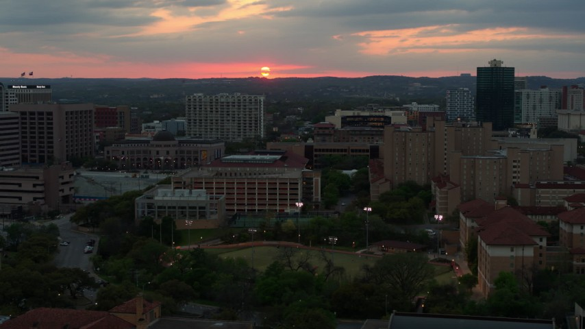 5.7K stock footage aerial video of the setting sun while flying near the university, Austin, Texas Aerial Stock Footage | DX0002_105_026