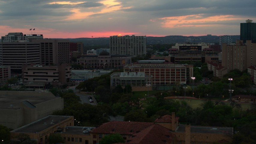 5.7K aerial video of the setting sun while passing near the university, Austin, Texas Aerial Stock Footage | DX0002_105_027