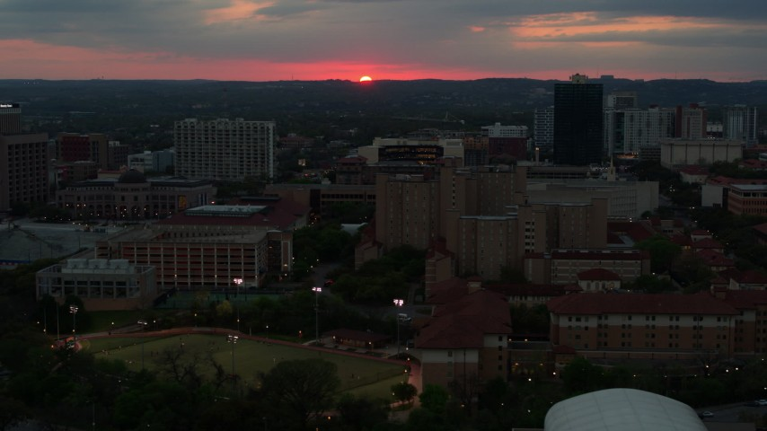 5.7K stock footage aerial video flyby the university campus with setting sun in distance, Austin, Texas Aerial Stock Footage | DX0002_105_033