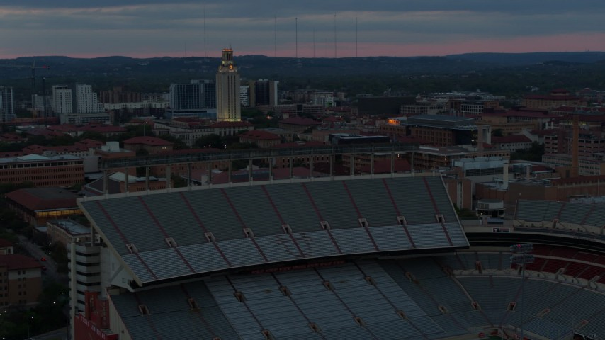 5.7K stock footage aerial video of UT Tower at the University of Texas at twilight, Austin, Texas Aerial Stock Footage | DX0002_105_035