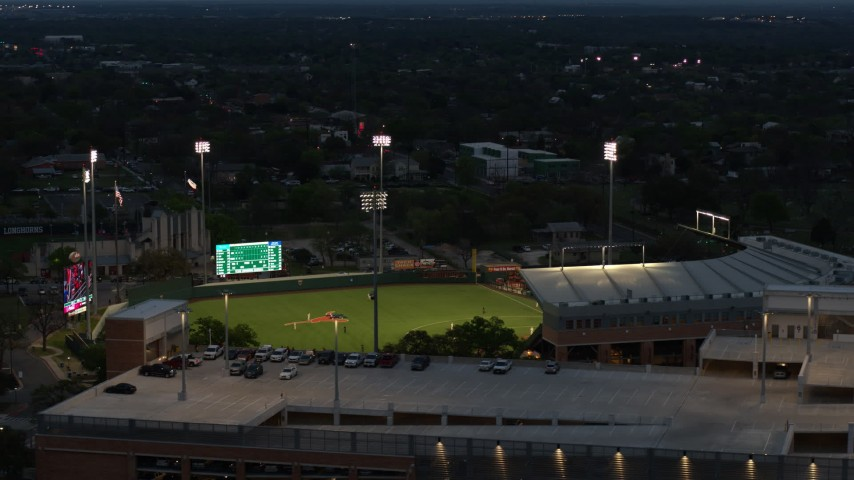 5.7K stock footage aerial video of ascending by baseball stadium at the University of Texas at twilight, Austin, Texas Aerial Stock Footage | DX0002_105_037