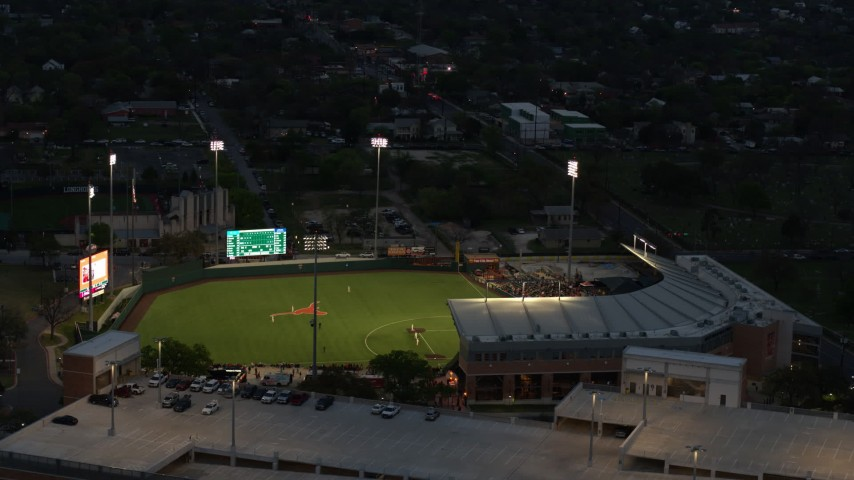 5.7K stock footage aerial video of a baseball game at a stadium at the University of Texas at twilight, Austin, Texas Aerial Stock Footage | DX0002_105_038
