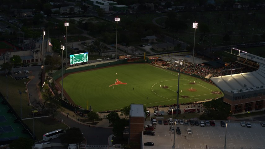 5.7K stock footage aerial video flyby a baseball game at a stadium at the University of Texas at twilight, Austin, Texas Aerial Stock Footage DX0002_105_039 | Axiom Images