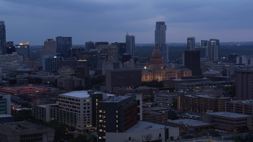 5.7K stock footage aerial video office buildings around capitol at twilight, skyscrapers in background in Downtown Austin, Texas Aerial Stock Footage | DX0002_105_040