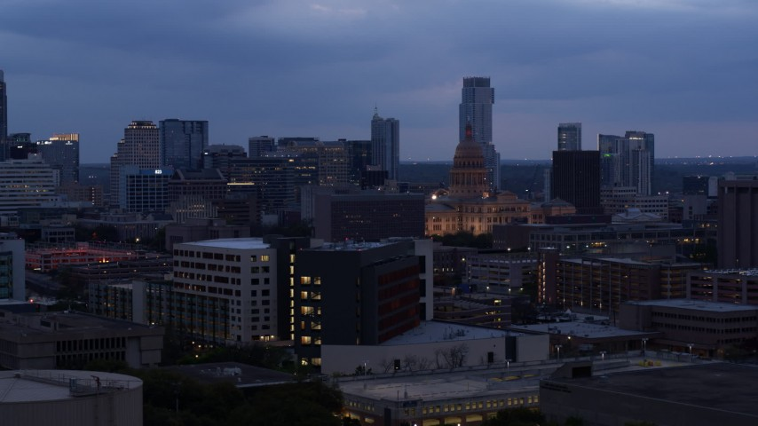 5.7K stock footage aerial video of office buildings around capitol at twilight, skyscrapers in distance in Downtown Austin, Texas Aerial Stock Footage | DX0002_105_042
