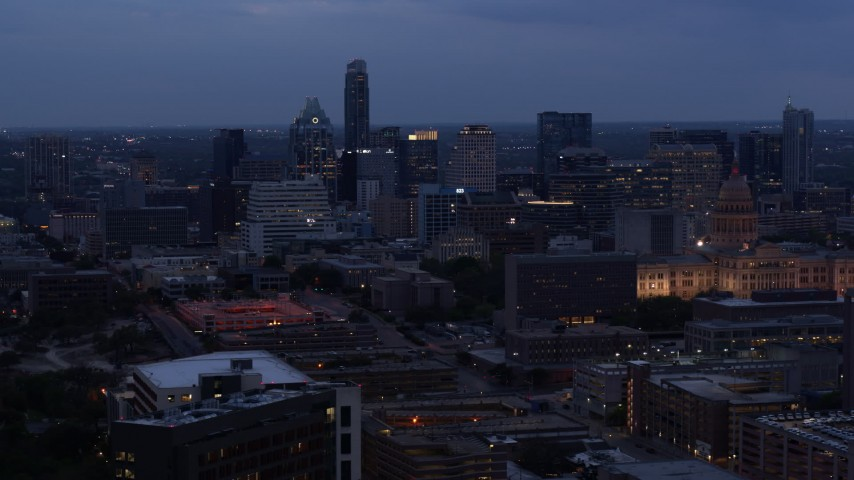 5.7K stock footage aerial video flyby office buildings and skyscrapers at twilight, reveal capitol in Downtown Austin, Texas Aerial Stock Footage | DX0002_105_043