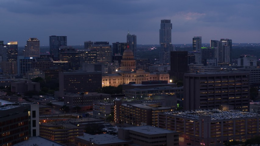 5.7K stock footage aerial video of a view of office buildings, capitol and skyscrapers at twilight in Downtown Austin, Texas Aerial Stock Footage | DX0002_105_048