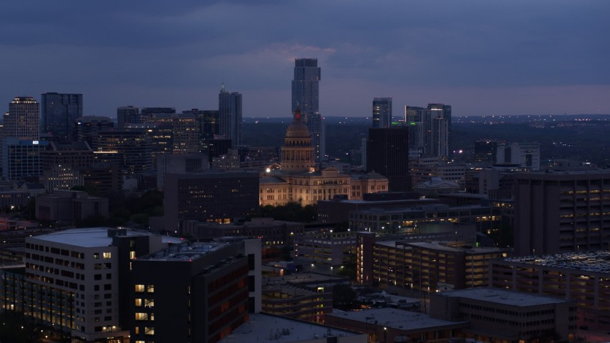 5.7K stock footage aerial video ascend near office buildings, capitol and skyscrapers at twilight in Downtown Austin, Texas Aerial Stock Footage | DX0002_105_050