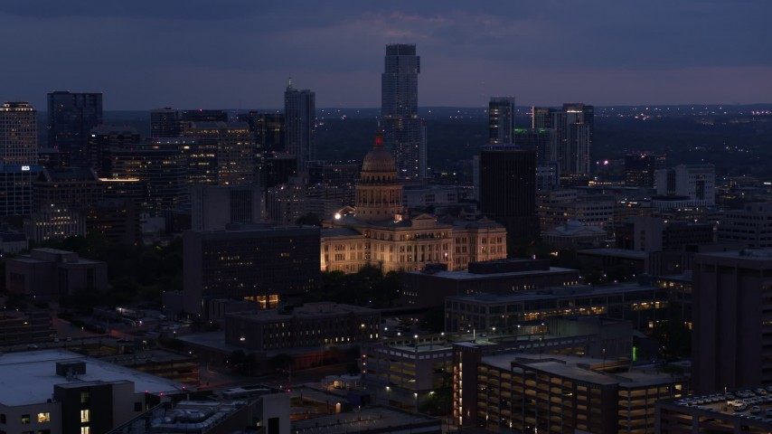 5.7K stock footage aerial video ascend near office buildings with view of state capitol at twilight in Downtown Austin, Texas Aerial Stock Footage | DX0002_105_053