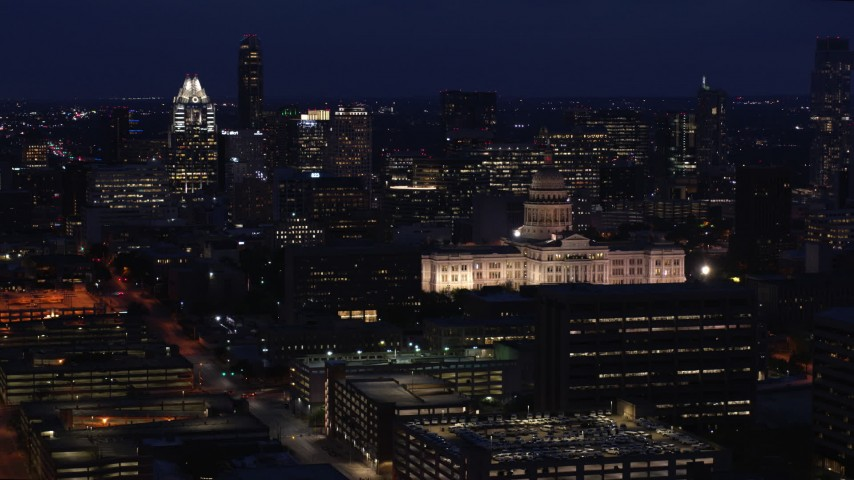 5.7K aerial video reverse view of office buildings, skyscrapers and capitol at night in Downtown Austin, Texas Aerial Stock Footage | DX0002_106_003