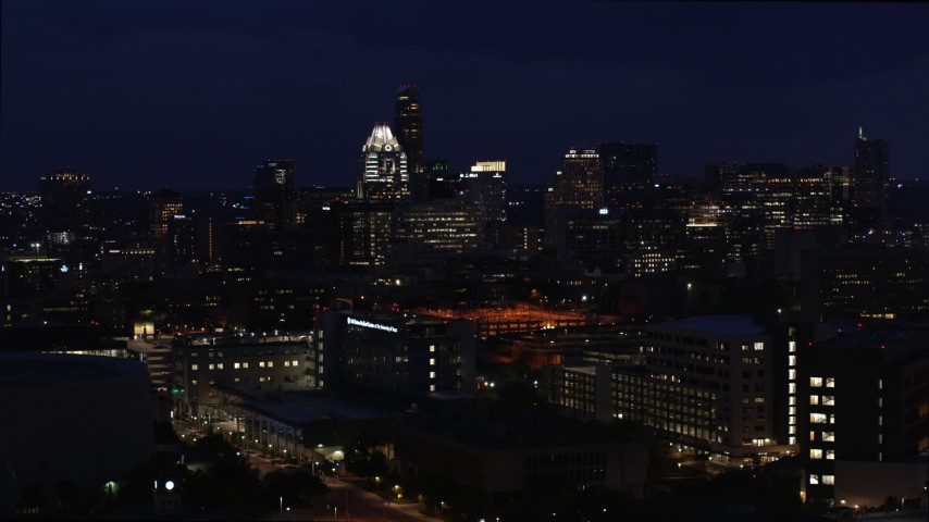 5.7K aerial video of office buildings, skyscrapers while descending at night in Downtown Austin, Texas Aerial Stock Footage | DX0002_106_005
