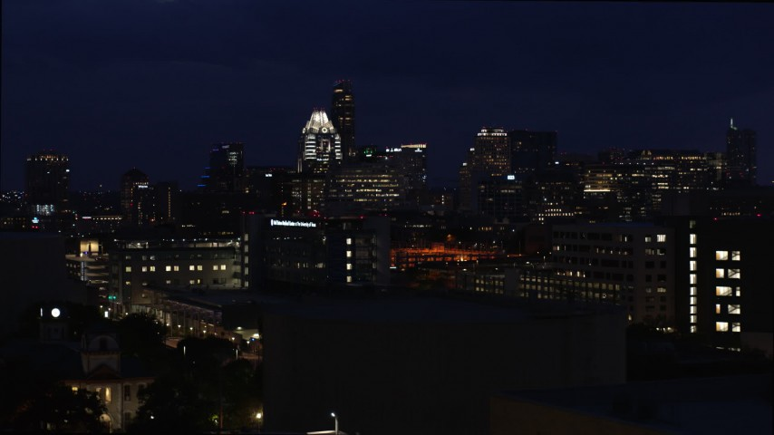 5.7K stock footage aerial video ascend and approach office buildings, skyscrapers at night in Downtown Austin, Texas Aerial Stock Footage | DX0002_106_006