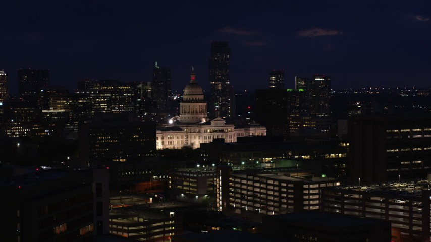 5.7K stock footage aerial video of passing the Texas State Capitol at night in Downtown Austin, Texas Aerial Stock Footage | DX0002_106_008