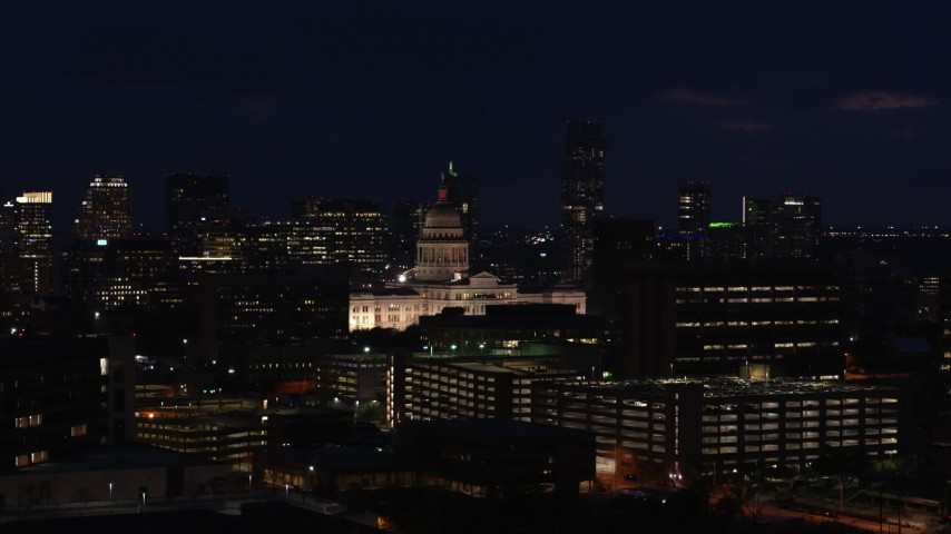5.7K stock footage aerial video of flying by the Texas State Capitol at night in Downtown Austin, Texas Aerial Stock Footage | DX0002_106_009