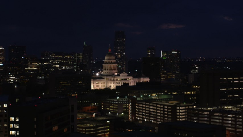 5.7K stock footage aerial video of slowly ascending toward the Texas State Capitol at night in Downtown Austin, Texas Aerial Stock Footage DX0002_106_010 | Axiom Images