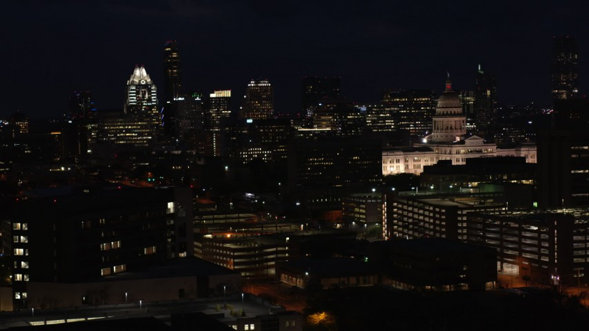 5.7K stock footage aerial video slow pass by skyscrapers, office buildings, Texas State Capitol at night in Downtown Austin, Texas Aerial Stock Footage DX0002_106_013