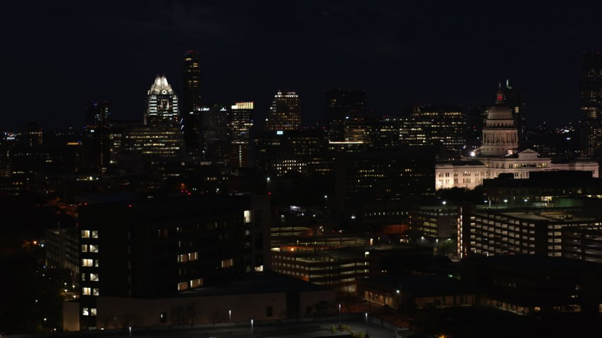 5.7K stock footage aerial video ascend with view of skyscrapers, office buildings, Texas State Capitol at night in Downtown Austin, Texas Aerial Stock Footage | DX0002_106_014