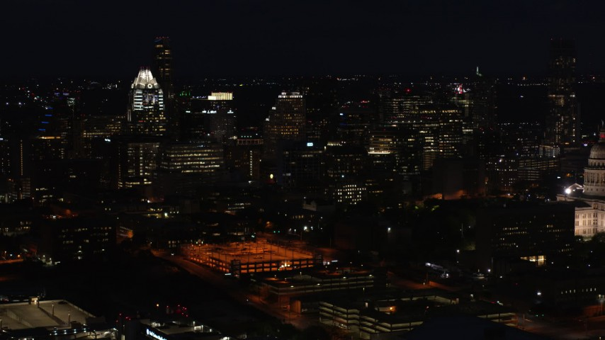 5.7K stock footage aerial video slowly fly toward skyscrapers and office buildings at night in Downtown Austin, Texas Aerial Stock Footage | DX0002_106_015