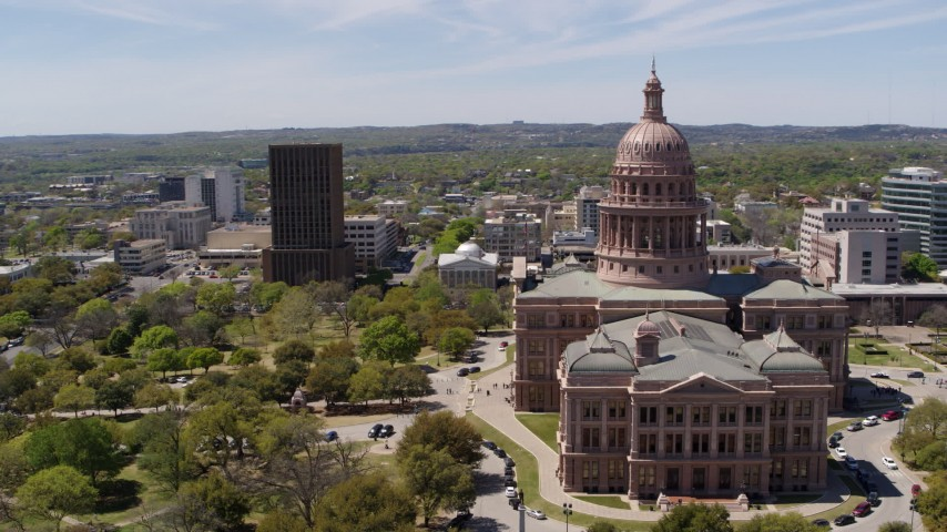 5.7K stock footage aerial video of orbiting the Texas State Capitol and grounds in Downtown Austin, Texas Aerial Stock Footage | DX0002_107_004