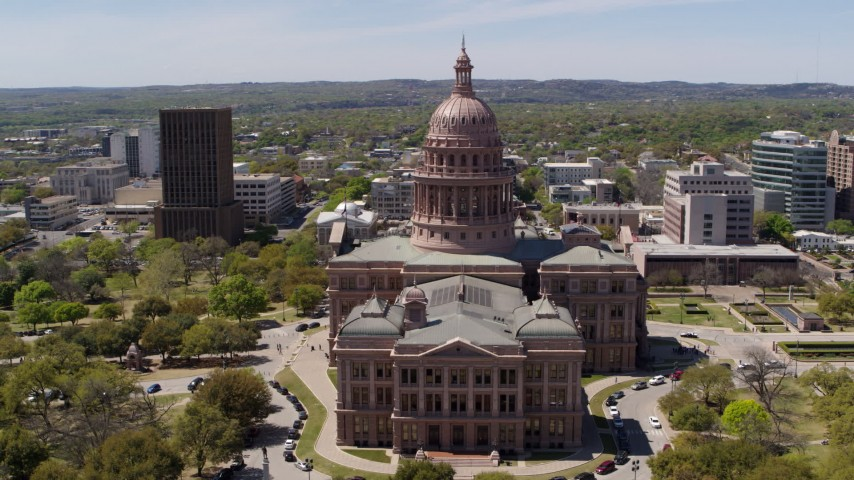 5.7K stock footage aerial video of orbiting the side of Texas State Capitol and grounds in Downtown Austin, Texas Aerial Stock Footage | DX0002_107_005