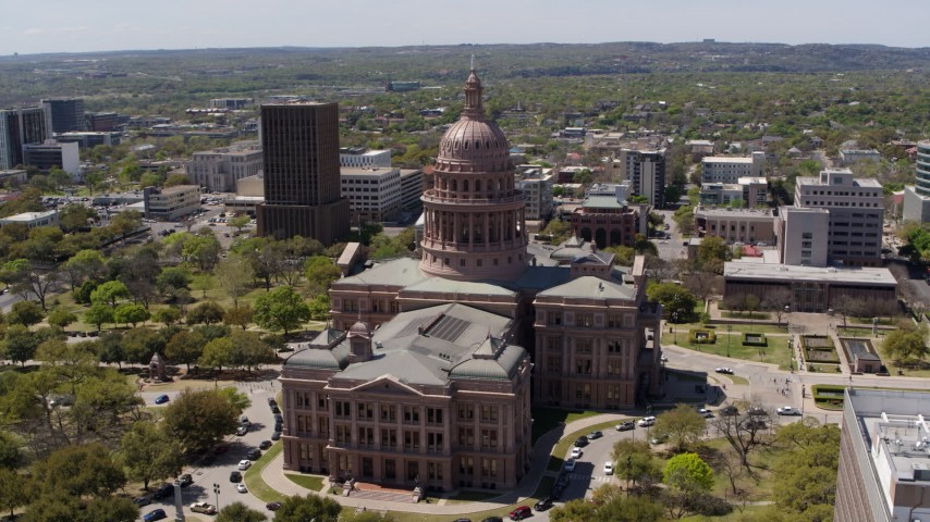5.7K stock footage aerial video of approaching the side of Texas State Capitol during ascent in Downtown Austin, Texas Aerial Stock Footage | DX0002_107_007