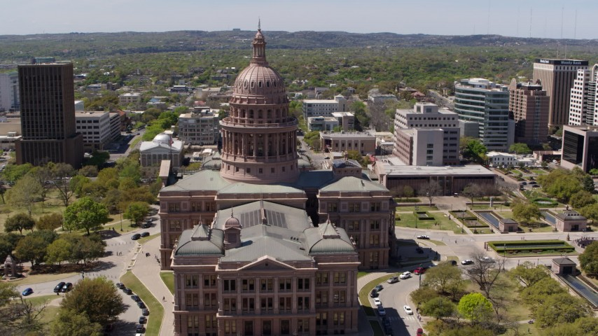 5.7K stock footage aerial video ascend while approaching Texas State Capitol in Downtown Austin, Texas Aerial Stock Footage | DX0002_107_010
