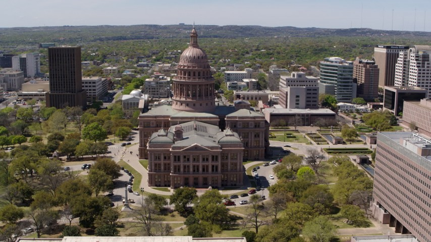 5.7K stock footage aerial video of a reverse view of the Texas State Capitol in Downtown Austin, Texas Aerial Stock Footage | DX0002_107_011