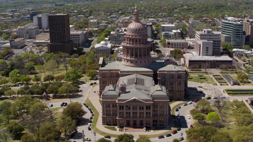 5.7K stock footage aerial video of flying away from the Texas State Capitol dome in Downtown Austin, Texas Aerial Stock Footage | DX0002_107_014