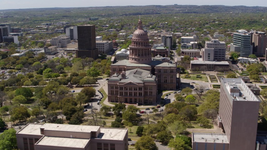 5.7K stock footage aerial video of a wide orbit around the Texas State Capitol dome and grounds in Downtown Austin, Texas Aerial Stock Footage | DX0002_107_015