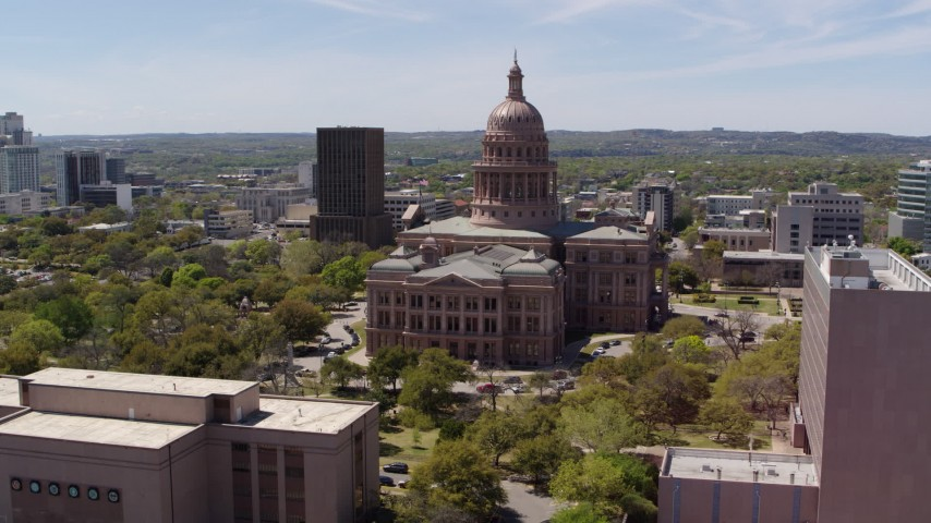 5.7K stock footage aerial video approach the Texas State Capitol dome from library and orbit in Downtown Austin, Texas Aerial Stock Footage | DX0002_107_018