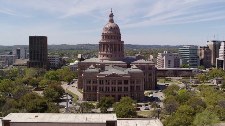 5.7K aerial video fly over library and approach the Texas State Capitol building in Downtown Austin, Texas Aerial Stock Footage | DX0002_107_020