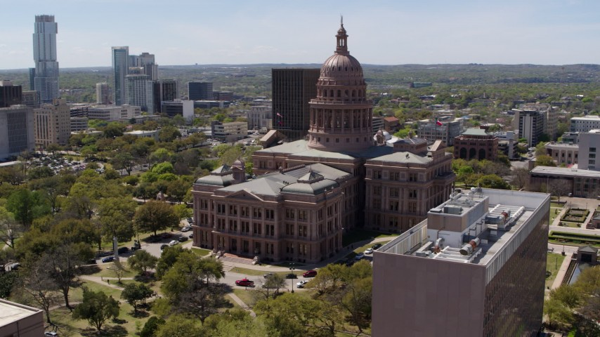 5.7K stock footage aerial video of circling the Texas State Capitol building in Downtown Austin, Texas Aerial Stock Footage | DX0002_107_022