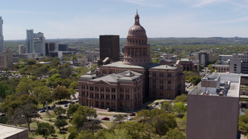 5.7K stock footage aerial video flyby government office building, approach Texas State Capitol in Downtown Austin, Texas Aerial Stock Footage | DX0002_107_024