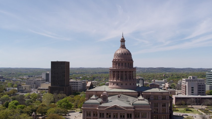 5.7K stock footage aerial video of orbiting around the dome of Texas State Capitol, Downtown Austin, Texas Aerial Stock Footage | DX0002_107_026