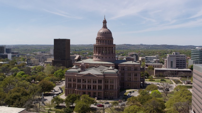 5.7K stock footage aerial video flying around the side of the Texas State Capitol, Downtown Austin, Texas Aerial Stock Footage | DX0002_107_027