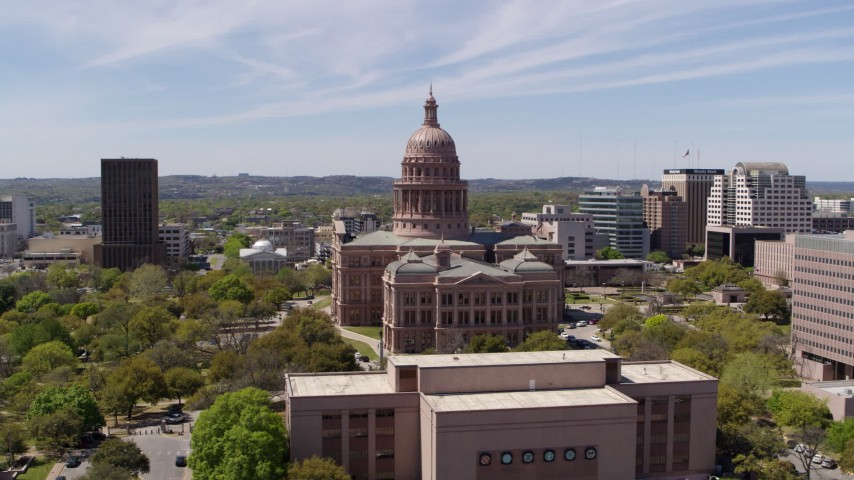 5.7K stock footage aerial video fly away from Texas State Capitol, descend near library, Downtown Austin, Texas Aerial Stock Footage | DX0002_107_028
