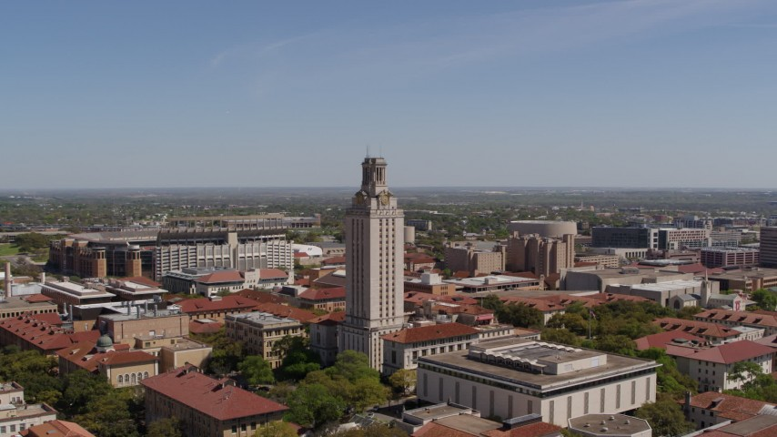 5.7K aerial video orbit UT Tower at the University of Texas during descent, Austin, Texas Aerial Stock Footage | DX0002_107_033